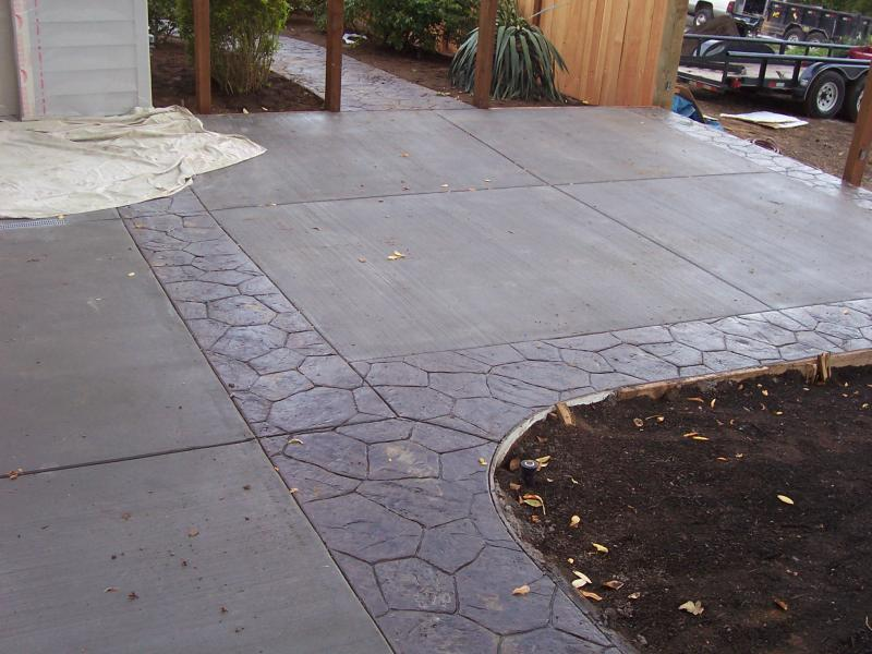 Stamp concrete random stone border around broom finish driveway eugene oregon