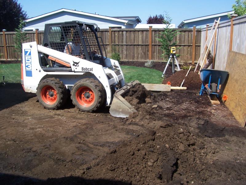 bobcat skidsteer excavation patio for expose aggregate finish concrete eugene